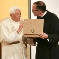 Pope Benedict XVI and Father O'Connell excitedly view and discuss the papal gift of the papyrus