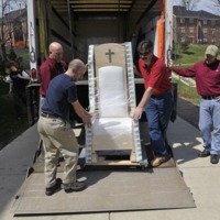 Moving company staffers carefully unloading the completed papal chair at the Pryzbyla Center