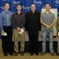 Essay winner, runner up, and honorable mention awardees with Father O'Connell