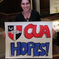 Student displays poster created at the banner/poster party