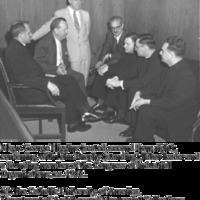 Msgr. George G. HIggins (seated second from right), conferring with John Brophy (standing), labor leader and founding member of the Congress of Industrical Organizations (CIO), ca. 1955