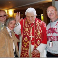 Members of The Catholic University community pose with cut-out of Pope Benedict XVI