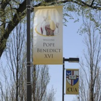 Papal welcoming banners on display along campus walkways and streets