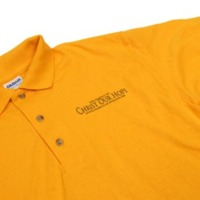 Brilliant gold polo shirt worn by event volunteers