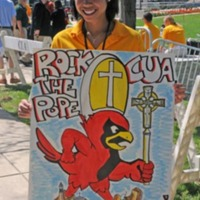 "Student volunteer exhibits her unique ""Rock the Pope"" poster"