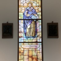 Stained Glass Window of St. Thomas Aquinas in the Busch School of Business St. Michael the Archangel Chapel