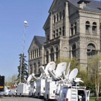 Local media vehicles outside McMahon Hall prepare for arrival of Pope