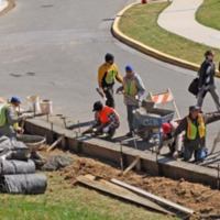 Campus facilities crew making road improvements