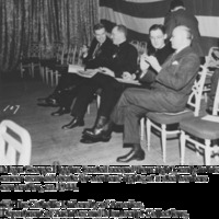 Msgr. George G. Higgins (seated second from right), early in his career as an advocate for workers' rights, at a steelworkers convention, ca. 1944
