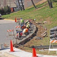 Campus facilities crew making further road improvements
