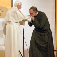 Father O'Connell formally greeting Pope Benedict XVI prior to the papal presentation on education