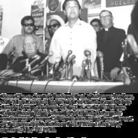 Cesar Chavez (center), leader of the United Farm Workers, with Msgr. George G. Higgins (right of Chavez), and Bishop Joseph Donnelly, Chairman of the U.S. Bishops' Committee on Farm Labor (left of Chavez), at a news conference in Fresno, California, discussing the settlement of the grape dispute between the UFW and over forty growers, May 21, 1970.