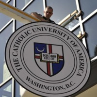 University seal being mounted to the Pryzbyla Center